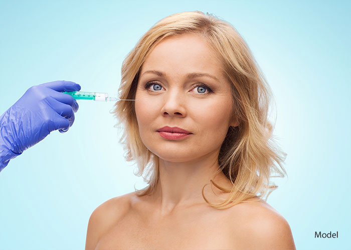 Woman getting filler injectable