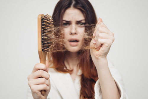 girl with a comb and problem hair