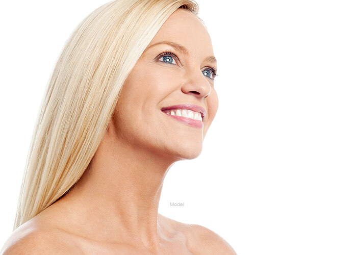 Woman smiling looking up